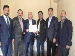 Gazeteci Taş'a teşekkür belgesi verildi